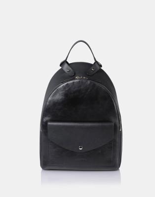 Queremos esta mochila de Jil Sanders. La queremos ya.